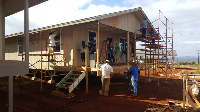 Eleele Habitat for Humanity. Workers working on a house being built