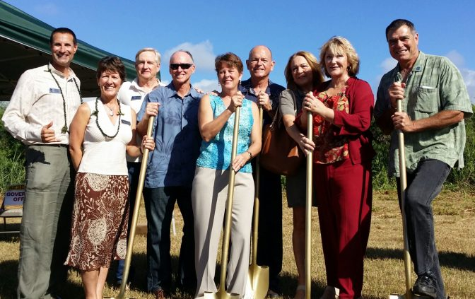 Group photo of team holding shovels for Habitat Humanity's ground breaking